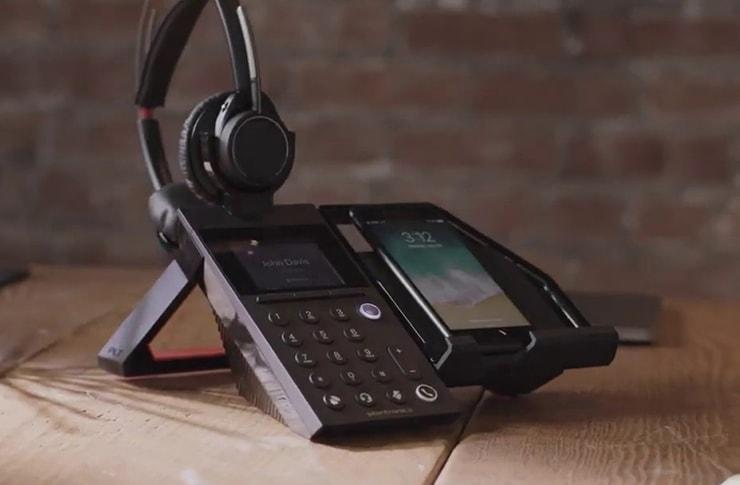 poly elara60 headset with mobile phone station lifestyle